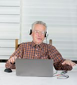 picture of rap  - Senior man listen music from laptop and make some rap movements - JPG