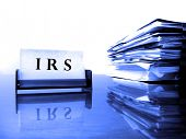 pic of irs  - IRS Card on desck with tax files - JPG