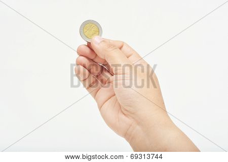 Hand Holding One Coin