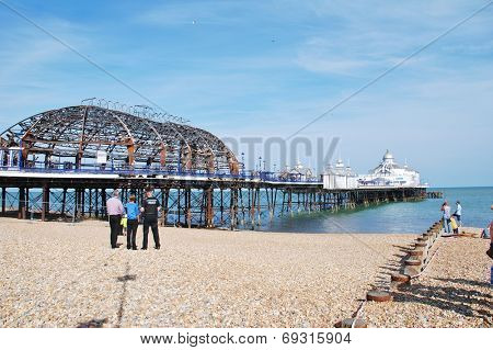 EASTBOURNE, ENGLAND - JULY 31, 2014: The historic Victorian pier after being badly damaged by fire on July 30, 2014. Designed by Eugenius Birch, the pier opened in 1870.