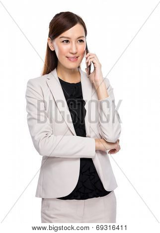 Asian businesswoman talk on mobile phone isolated on white background