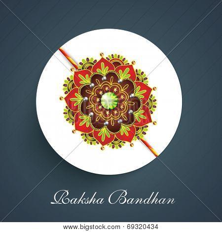 Beautiful colorful rakhi on blue background for the celebrations of Hindu community festival Raksha Bandhan celebrations.