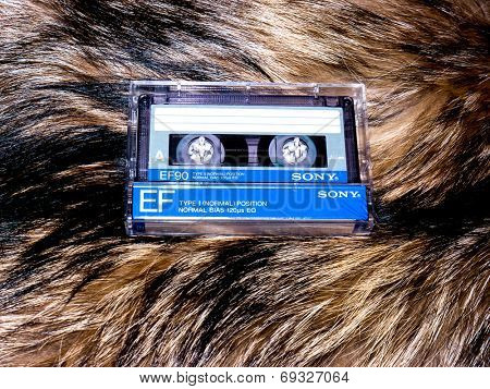 GOMEL, BELARUS-JUNE 11,2014:Sony cassette tape  on fur background. Sony Corporation, commonly referred to as Sony, is a Japanese multinational  corporation headquartered in Konan Minato, Tokyo, Japan.