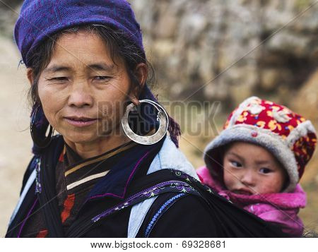 Hmong Woman Carrying Child And Wearing Traditional Attire, Sapa, Vietnam