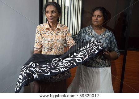 COLOMBO, SRI LANKA - MARCH 12, 2014: Local women in batik workshop. The manufacture and export of textile products is one of the biggest industries in Sri Lanka.