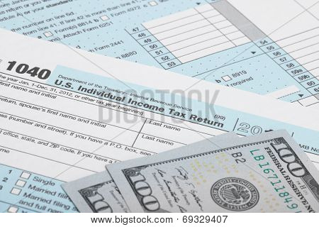 Usa 1040 Tax Form With Two 100 Us Dollar Bills