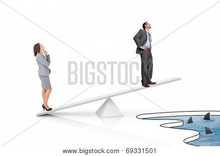 White scales measuring businessman and businesswoman over shark infested water