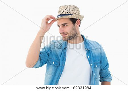 Handsome hipster wearing a trilby on white background