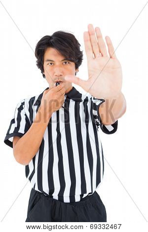 Stern referee showing stop sign with hand on white background