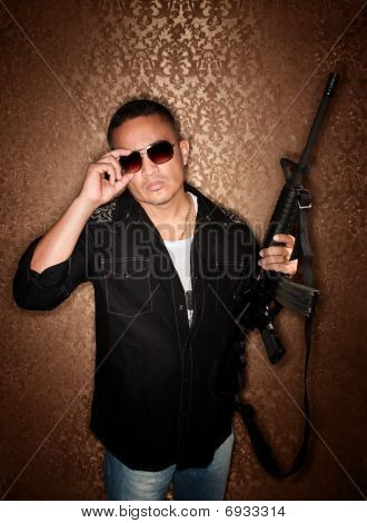 Hispanic Man With Rifle