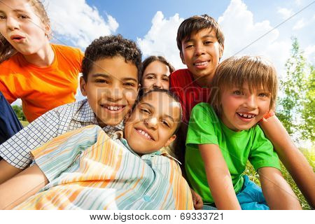 Close up view of smiling kids in a cuddle
