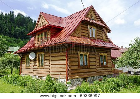 Traditional House Made Of Wooden Logs In Zakopane