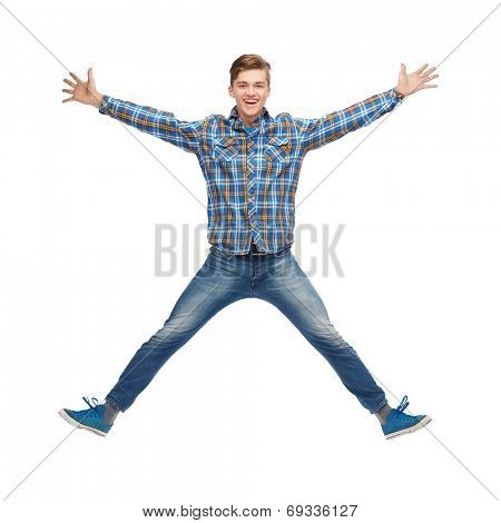 happiness, freedom, movement and people concept - smiling young man jumping in air