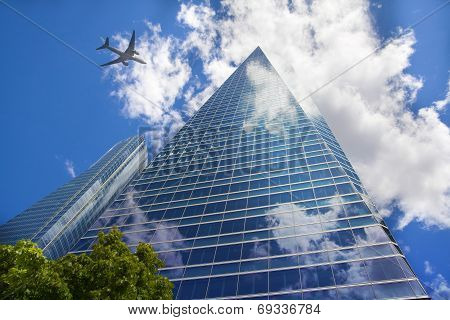 LONDON, UK - JULY 20, 2014: Aircraft over the London's skyscrapers going to land in the City airport
