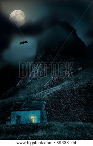 Halloween background with old wooden house