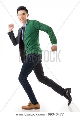 Asian young man running with casual clothes mix business suit, concept of life and work balance.