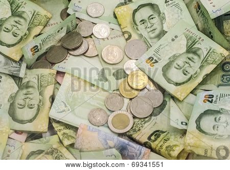 Thai Baht Note And Coin Money Display As Background