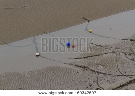 Mooring Chains, Ropes And Buoys, Beach At Low Tide.