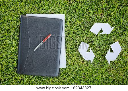 Recycling Symbol And Business Documents