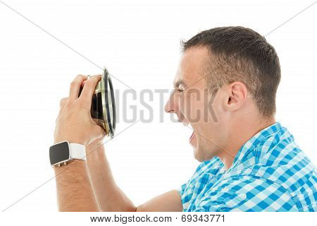 Young Man Holding Object Loudspeaker Listening To Loud Music Yelling