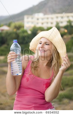 Young Beautiful Summer Woman On Vacation With A Large Bottle Of Mineral Water