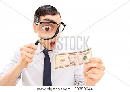 Excited man looking at dollar bill with magnifier isolated on white background