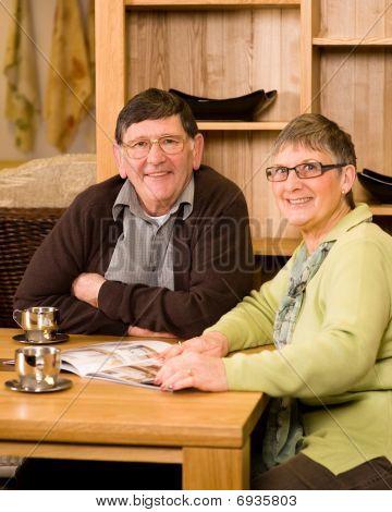 Senior Man And Woman Couple Looking At