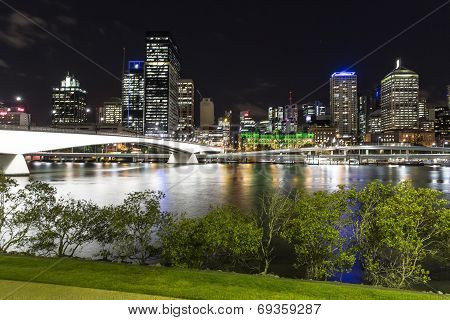 Brisbane cityscape and Victoria bridge by night over the Brisbane river