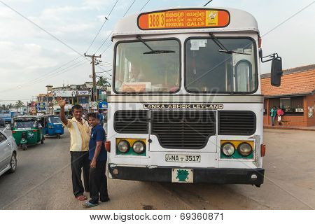 GALLE, SRI LANKA - FEBRUARY 22, 2014: Large public transport bus stopped on street. Buses are the Sri Lankan principal mode of public transport.