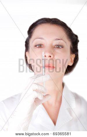 Female Nurse Checking Empty Syringe