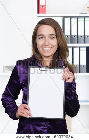 Woman Is Showing A Clipboard With A Sheet Of Paper