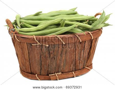 French beans in wooden basket isolated on white