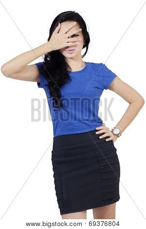 Asian Woman Peeking From Fingers