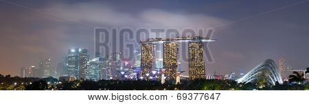 SINGAPORE - 31 DEC, 2013: Panoramic view of Singapore city skyline at late sunset. Marina Bay Sands downtown district is extremely popular travel destination in Asia