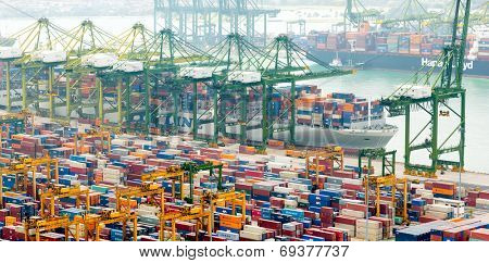 SINGAPORE - 2 JAN, 2014: Commercial port of Singapore. Cargo ships loading and unloading containers in industrial port. One of most important warehouses and trade docks for economy of Asia