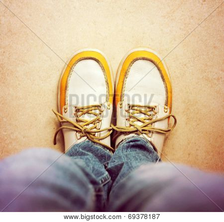 a shot of yellow and white boat or deck shoes toned with a retro vintage instagram filter