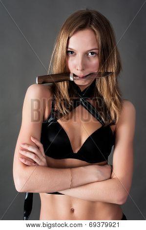 Pretty girl holds knife in teeth