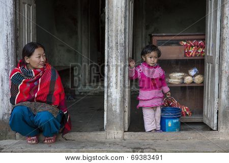 A Woman With Her Daughter In Panauti, Nepal