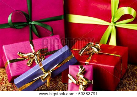 Six Bows Tied around Unicolored Gift Boxes