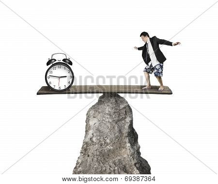 Man Balancing Against Alarm Clock At Hilltop