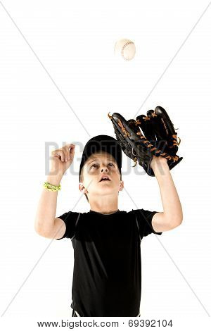 Young Boy Baseball Player Focusing On Catching The Ball