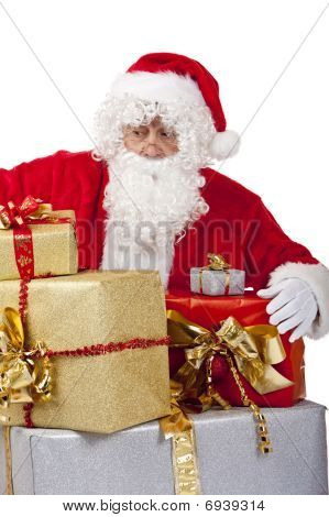 Surprised Santa Claus On Knees With Big Stack Of Christmas Gift Boxes