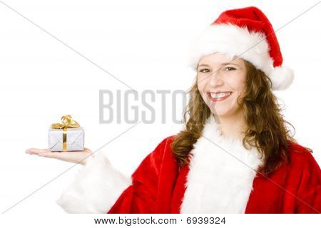 Young Happy Woman With Santa Claus Costume Is Holding Christmas Gift In Hand