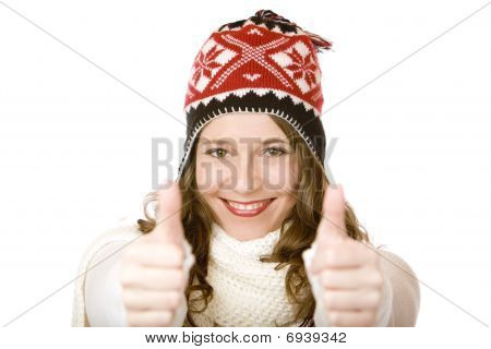 Young Happy Smiling Woman With Cap And Scarf Shows Both Thumbs Up