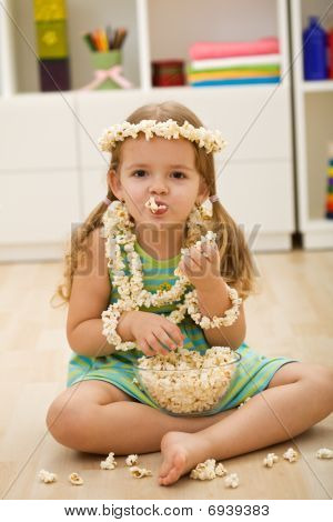 Happy Little Girl With Popcorn
