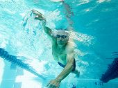 picture of senior adult  - underwater view of senior man swimming competitively  - JPG