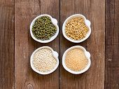 foto of mung beans  - Raw Organic Amaranth and quinoa grains wheat and mung beans in small bowls - JPG