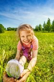 stock photo of leg-split  - Smiling girl making leg - JPG