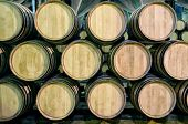 stock photo of wine cellar  - Old barrels for Whisky or wine in cellar - JPG
