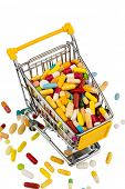 stock photo of placebo  - colorful tablets in the shopping cart icon photo for healthcare costs - JPG